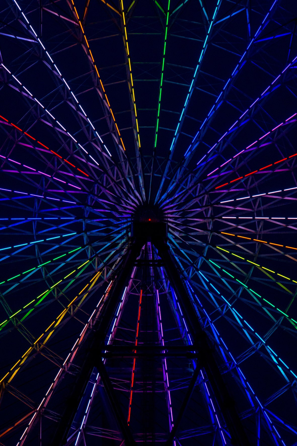 Photo of a rainbow light up ferris wheel