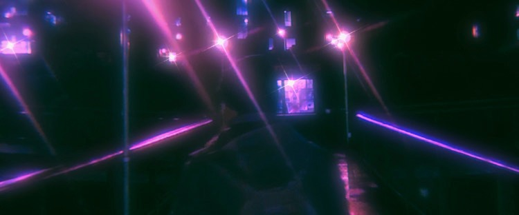 Photo of the back of a person wearing a backpack, city lights reflective and shining in pinks and blues