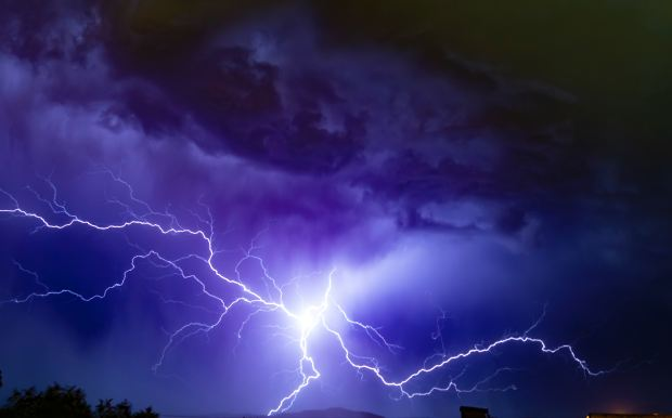 low-angle photography of lightning in purple-blue sky